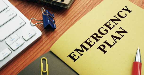 """Folder on a desk with """"Emergency Plan"""" on the front"""